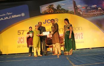 Receiving NTTTS certificate from JCI National President